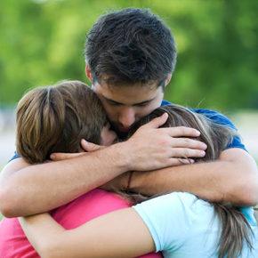 child hugging kids
